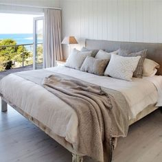 Our loose cover bedhead looking beautiful among the layers of cushions and throw in this room with a view. Linen bedheads in queen and king size all in stock. A few colours to choose from