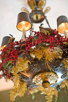 Jazz up a light fixture with garlands or a sprig of mistletoe - Traditional Home®