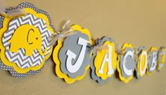 Elephant Chevron Stripe Polka Dot Gender Neutral Its a Boy or Girl or Name Banner Yellow Gray Baby Shower or Birthday Party Decorations. $26.00, via Etsy.