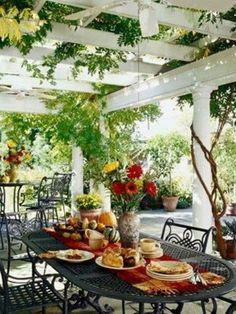 Nice idea - white painted trellis/pergola with climbing vines covering an outdoor dining room. Sweet!