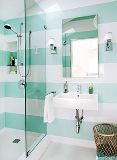 Aqua and white striped bathroom...makes us want to break out the Whisper White and Pool party!
