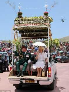 Hundreds of wellwishers gathered at Port Moresby to catch a glimpse of Prince Charles and the Duchess of Cornwall on the second day of the Royal couple's tour of Papua New Guinea