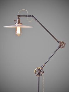 This is one smart looking lighting device. Perfect for your vintage industrial or steampunk décor. Vintage industrial style floor lamp modeled after early 20 th century designs.