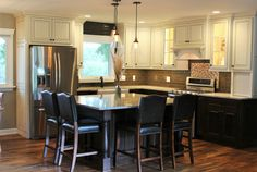 A large single-level #kitchen #island in a #Traditional styled kitchen.   |   VillageHomeStores.com