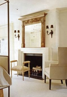 This architectural detail (mirror) is a brilliant focal point ...above a sleek hearth ...Darryl Carter pic#3