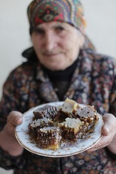 Beekeeper Sofik Nikolyan, 75, is proud with the honey she produces from her bee hives in the mountains of Vayots Dzor Region, Armenia by UNDP in Europe and Central Asia, via Flickr