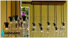 Lámpara con diseño de base de madera para pizza y con frascos de vidrio. #Hangaro #Guatemala #CreacionChapina #Vidrio