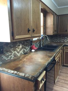 kitchen renovation concrete countertops glass tile backsplash laminate floors