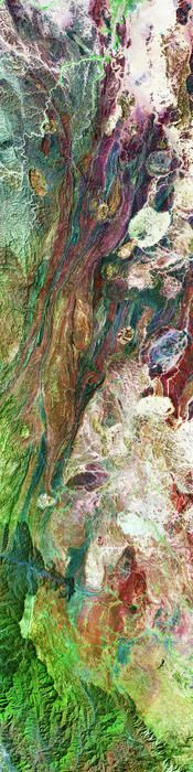 Enhanced NASA image of rugged mountains and geological features in southern Saudi Arabia.