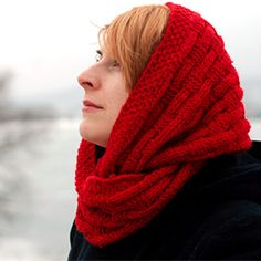 A knitted in basketweave pattern red infinity or loop scarf will keep you warm during cold winter time. Free pattern