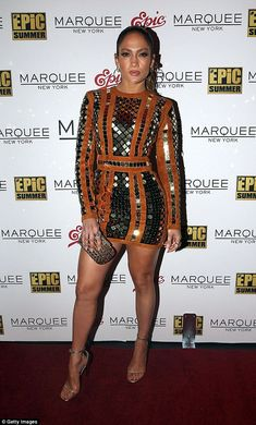 Centre of attention: Jennifer Lopez wowed in a gold dress as she rocked the red carpet at ...