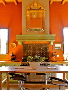 Spanish Decor in Colorful Kitchen - love this color! And the rafters and windows!