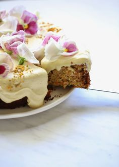 CARROT CAKE WITH MACADAMIA NUT CREAM CHEESE FROSTING - Deliciously Legal