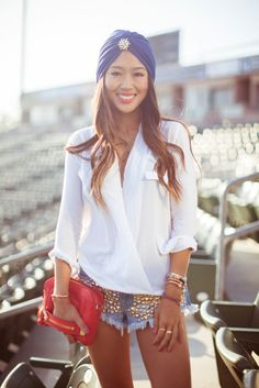 Pair embellished shorts with a neutral top and a bright purse for a fashion forward look.
