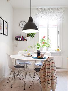 Breakfast nook // eames chairs // pendant light