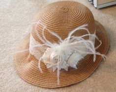 Cloche hat with feather & rose embellishment