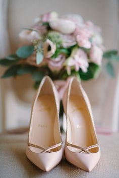 The bride's ivory ensemble was lent a touch of color by her pointed-toe, blush Christian Louboutin pumps. #PinkHeels #Louboutin Photography: Milton Photography. Read More: http://www.insideweddings.com/weddings/inspirational-pastel-wedding-at-a-french-chateau-in-paris-france/650/