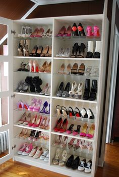Cheap bookcase turned into shoe storage.  Get extra boards cut at Home Depot to add more shelves and maximize space.  Because over the door shoe things just suck!