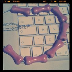 Pink porcelain bones on silver chain.