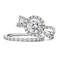 "Sterling Silver Halo style open work engagement ring with round center CZ and matching CZ encrusted wedding band.· Engagement ring center stone: 1 1/2 ct. CZ  (total diamond weight equivalent)· ImportedSTERLING SILVER is the standard for fine silver jewelry in the world over. Only Sterling Silver can be stamped with a ""fineness mark"" of .925 indicating its high quality."