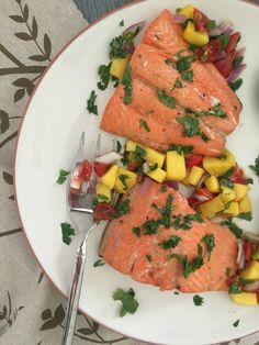 Orange Lime Salmon with Mango Salsa: is simple, nutritious and versatile.  You can bake or grill this salmon, eat it aside a salad and side dish or over a bed of greens.  The sweet, fruity flavors pair nicely with the salmon and make it a family favorite and a great dish for lent. // A Cedar Spoon #WildAlaskaSeafood #CleverGirls #ad