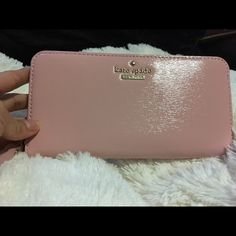 Kate Spade Lacey Wallet ♠️Kate Spade♠️ Lacey wallet. Never used. New with tag. Authentic. Color is Rosejade. No trades. Price is negotiable. kate spade Bags Wallets