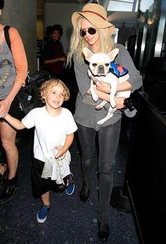 Ashlee Simpson carried her dog while walking through the airport with son Bronx in L.A. June 10.