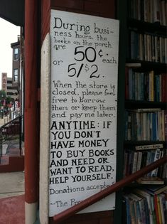 """Sign in front of the Paradox Bookstore in Wheeling, West Virginia. According to IndieBound, the owner is the playwright Tom Stobart, who opened the shop thirty-five years ago. """"We like his benevolent approach to ensuring that the good people of Wheeling (and any lucky visitors) always have something to read."""""""