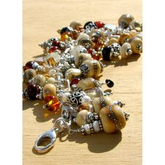 Teresa does cool lampwork too.  Charm bracelet Ancient Riches by tajones1463 on Etsy