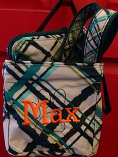 Thirty One Littles Carry All Caddy-   holds Max's Pet Wristlet and Pet Collar that all match in Sea Plaid.