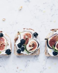 Labneh smeared toasts with sumptuous sliced fig, blackberries + minted olive oil