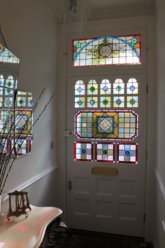 Late Victorian white door with stained glass panels- Edwardian Splendour - Voysey & Jones #doors #stainedglass More