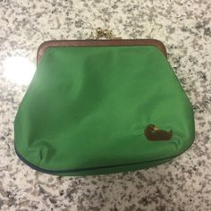 Dooney and Bourke Purse Green and pink with navy stitching on the bottom nylon large frame purse. Great condition, hardly used. Come from non-smoking household. No trades please but offers are welcome :) Dooney & Bourke Bags Mini Bags