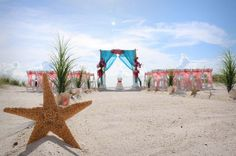 Starfish, grasses and conch shells line the aisle