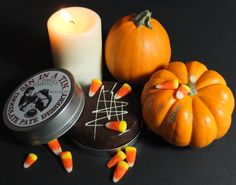 Celebrate Halloween with Sin In a Tin. Snack Idea: Dip your candy corn into this delicious SIAT chocolate for a delicious treat!