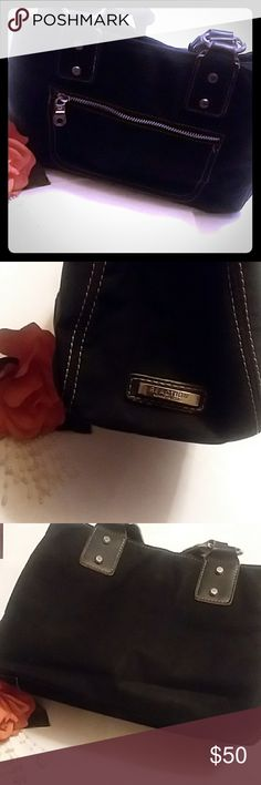 🏆TODAY SPECAIL🏆Kenneth Cole Reaction Handle Bag Pre owned Beatiful black stiched with white  and silver hardware, the linning is cleaned but the little pocket in the compartment has a few marks see pic see pic. Over all 9 out of 10 is my rating for the purse..Great for a everyday bag or a night out on the town.. This bag is made of high qualify Kenneth Cole Reaction Bags Satchels