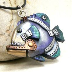 Long time no new designs lol Who doesn't love a good angler fish? Polymer clay, swarovski crystal, wire, metallic wax and paints, metal brad This piece is currently for sale! When it is sold, you c...