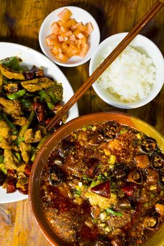 Chinese Sichuan Dishes: 'water-boiled' beef, pig intestines deep-fried  with fresh green and dried red chilies or pickle.