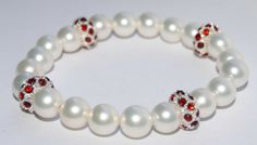 Natural pearl bracelet with red CZ accents by JewelryBinge on Etsy, $32.00