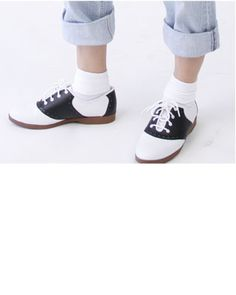 Peddle pusher pants, bobby socks, and saddle shoes: 1950s fashion for girls.  No, no, no!  The socks are all wrong....those are from the 1940's.  In the '50's we wore the crew sock that did NOT fold over......