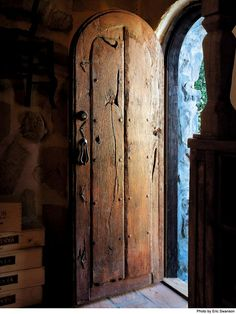 Again, love old, wood doors! Just feel the love and time it took to create such an entry.