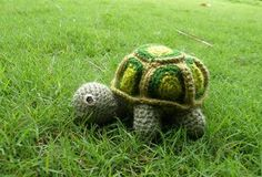 Adorable Turtle Amigurumi that can come out of its shell, or you can sew shell to body. The underside of the shell is a vest with buttons on it.