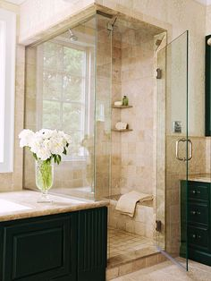 Custom Showers! Nice color scheme with different textured materials: wood, glass, and tiles....