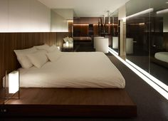 The Tokyo Towers_Guest Room by CURIOSITY.  Beautiful way to use tinted glass, very chic.....