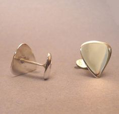 For the guitarists who like to potray their personality even when they're suited up - Guitar pick Cufflinks