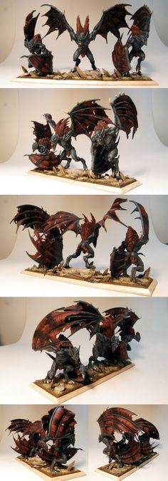 Mutated Vampire miniatures painted and slightly converted for Warhammer Fantasy Battle - or Age of Sigmar if need be. Those are Vargheists made by Games Workshop. In AoS they would belong to the Soulblight faction, Death Grand Alliance.