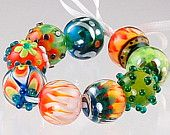 Colorful Bright Orange, Turquoise, White and Green Beads With Bright Silver Accents On Handmade Lampwork Beads