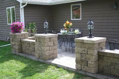 """Our patio walls would look similar to this; but the posts for the roof would be in the center of the """"pillars""""."""