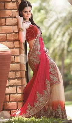 Interest oceans of attention dressed in this cream and pink net georgette embroidered sari. This engaging dress is displaying some great embroidery done with stone, cut dana, resham and shimmer border work. #AlluringTrendsetterSari