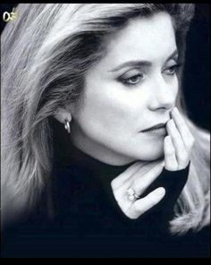French actress and model Catherine Deneuve...  This woman has aged so gracefully.  Still gorgeous ....